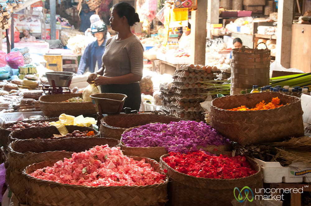 Baskets full of flower petals at the market to be used for canang sari creation.