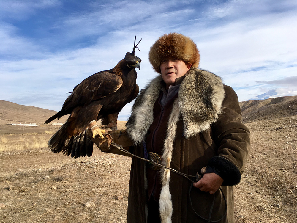 "A golden eagle and his master up on the ""jailoo,"" or high pasture."