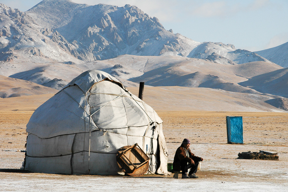 Morning tea outside the yurt at Song Kul Lake. With the first snowfall, the shepherds will soon pack up the yurts to go back to the village.