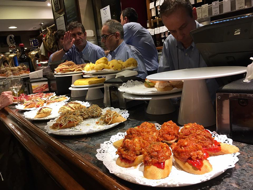 Bartenders and trays of pintxos at the ready in San Sebastian.