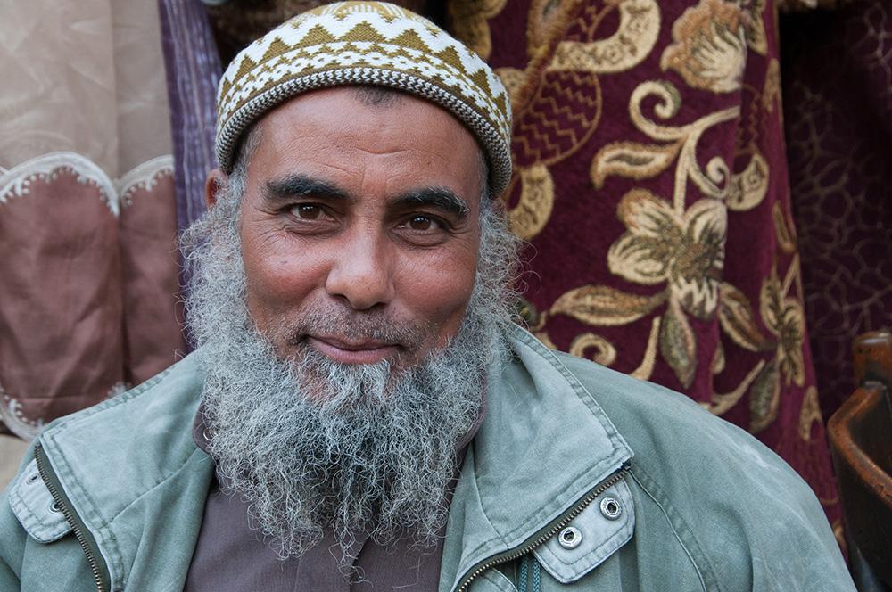 A friendly vendor in the Souq District.