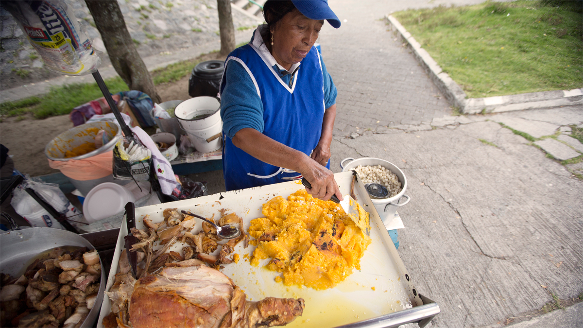 Quito street food vendor. Fewer travellers means fewer opportunities for people in local communities.