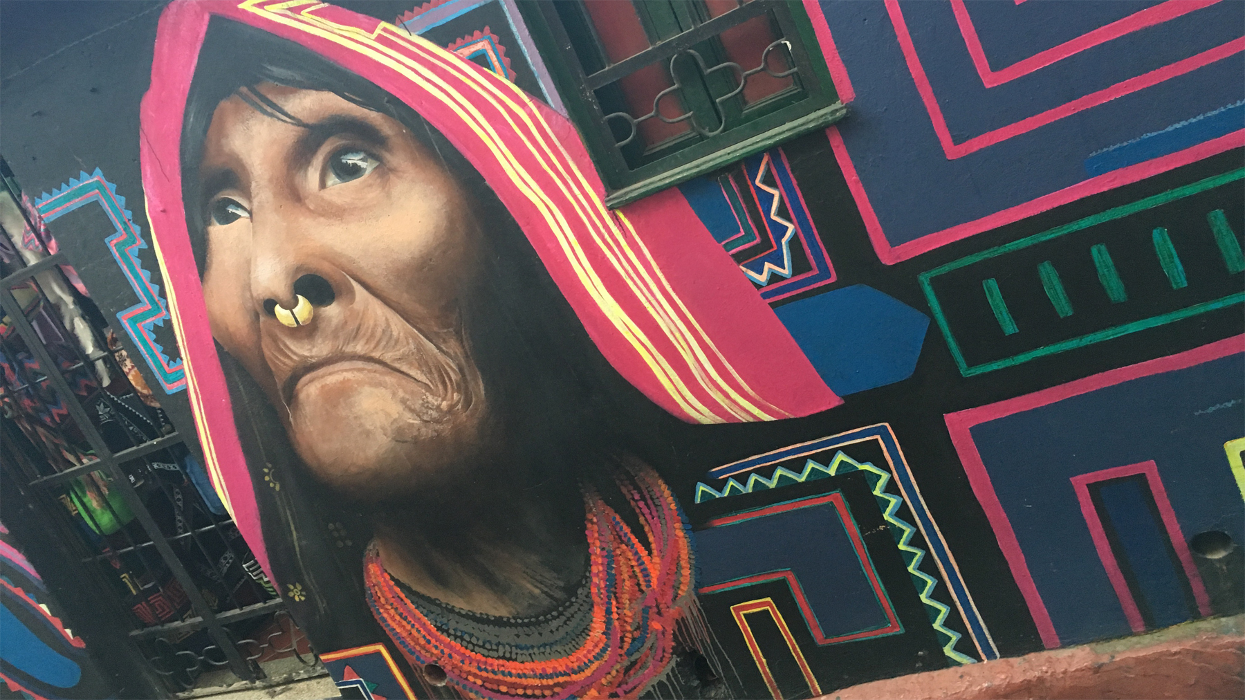 A portrait of an indigenous Cuna woman by Bogotá street artist Carlos Trilleras located on the narrow laneway of Calle del Embudo, near Plaza del Chorro de Quevedo.