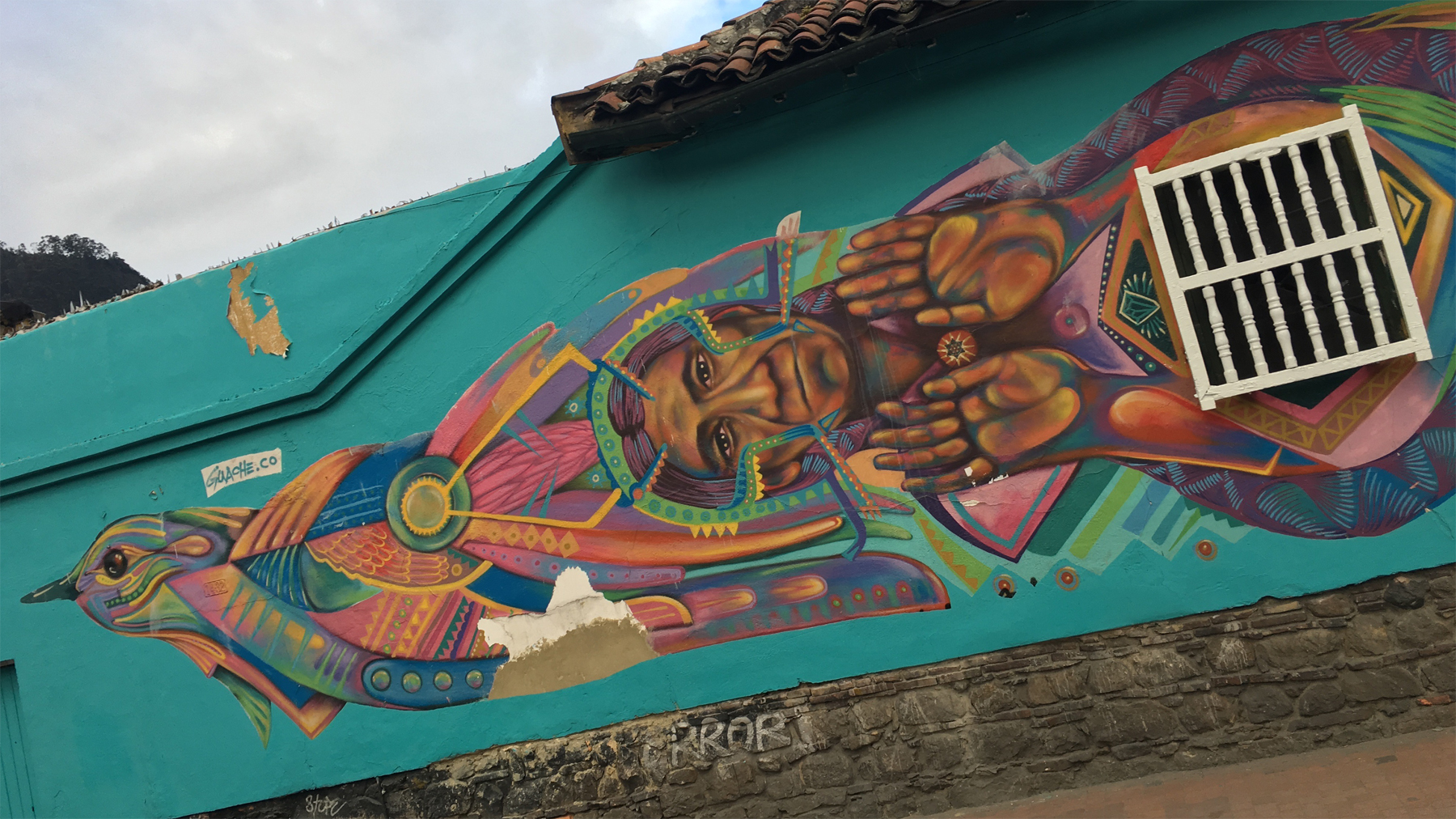 Guache's artwork mixes styles of Latin America's traditional muralism with graffiti and street art.