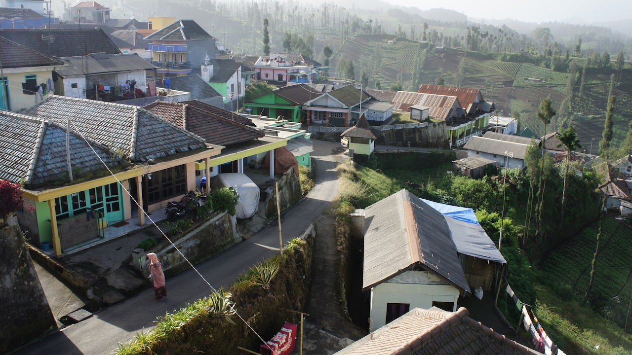 G Adventures travellers stay in a traditional home inside Bromo-Tengger-Semeru National Park.