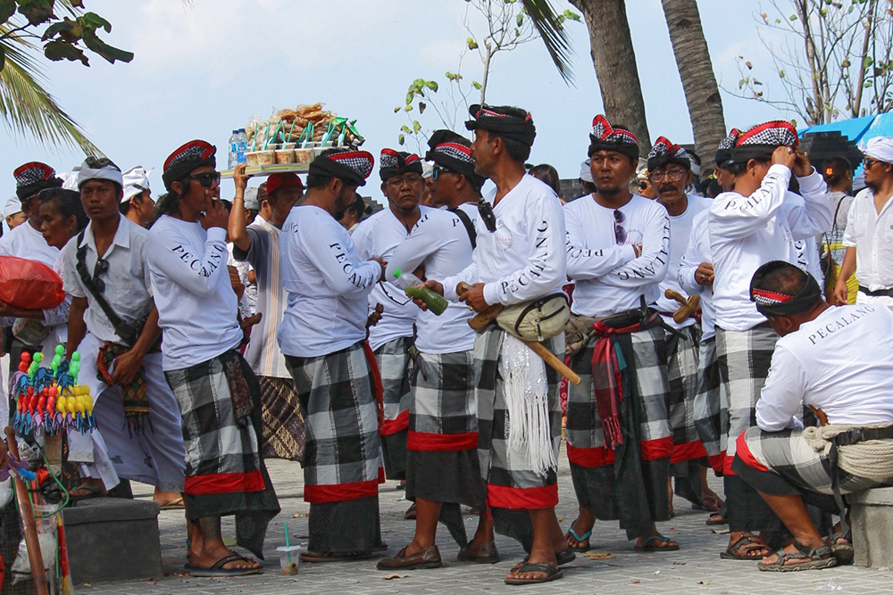 Men in Bali wear the traditional saput poleng cloth. Photo courtesy of Sue.