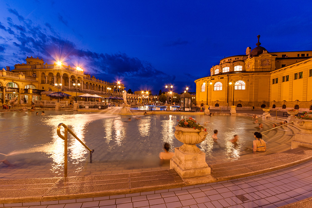 Locals and travellers alike take in the baths in the evening.