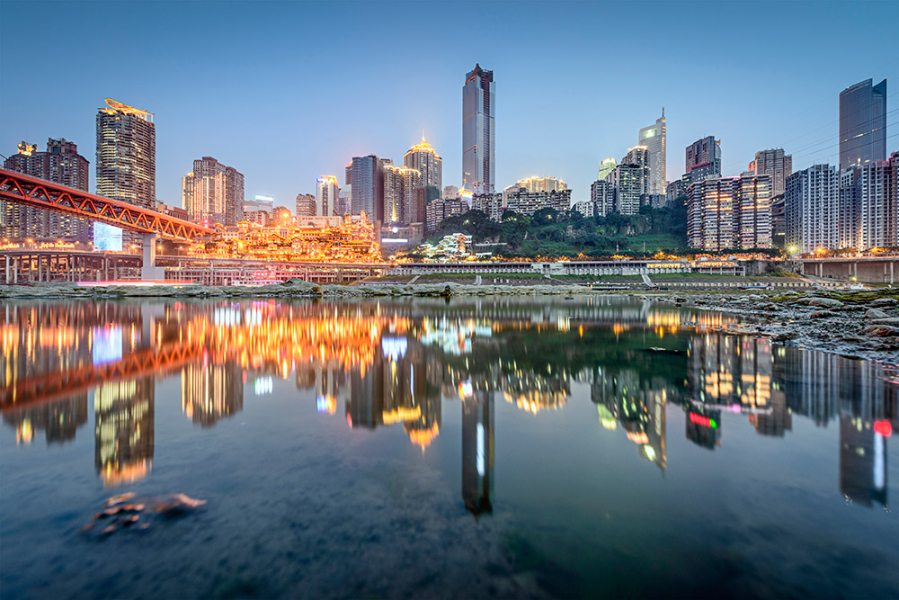 Dusk takes hold in Chongqing. The night markets are soon to open.