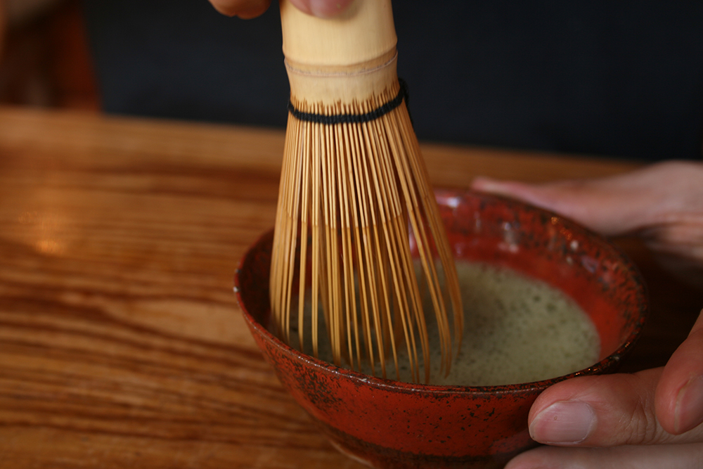 Matcha powder is whisked into hot water to create matcha tea. Photo courtesy of Akuppa John W.