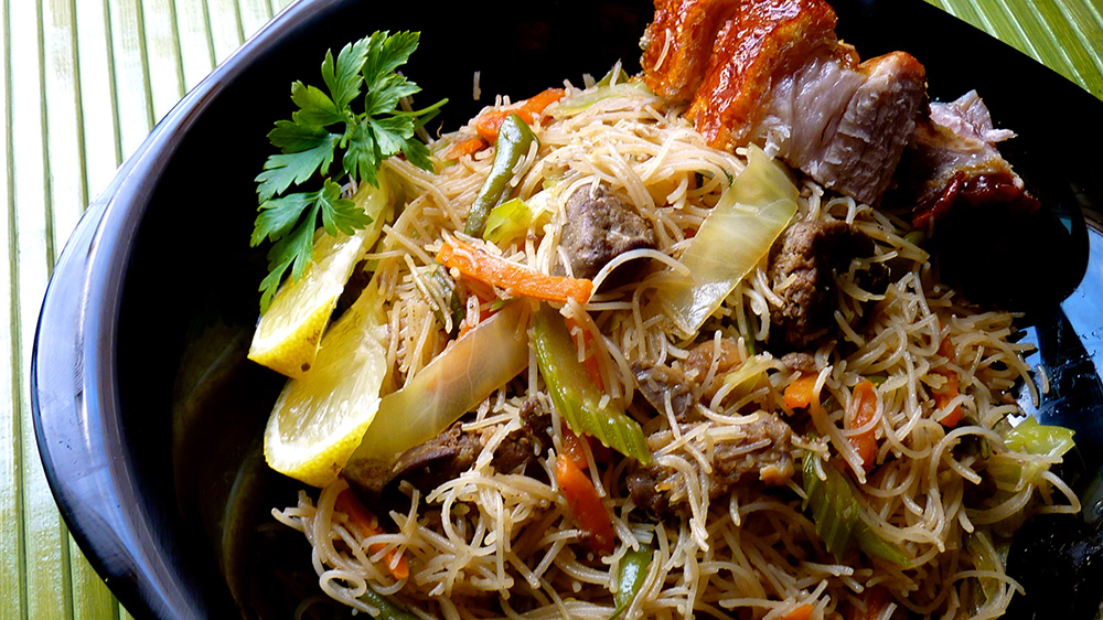 A variety of pancit, a Filipino noodle dish. Photo courtesy of Allan Reyes.