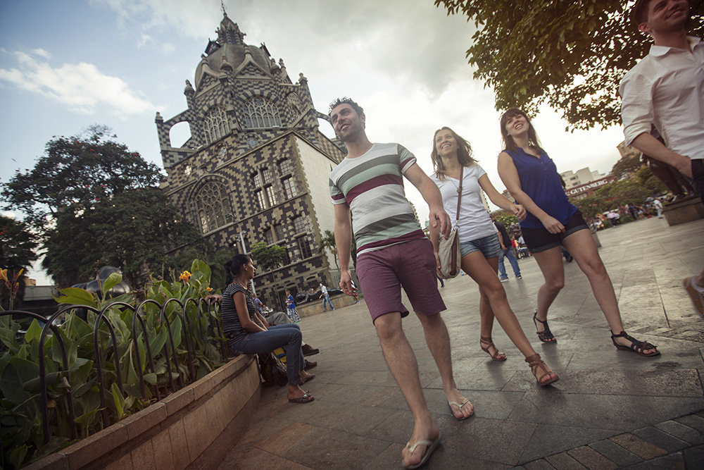 Pedestrians enjoy modern-day Medellin.