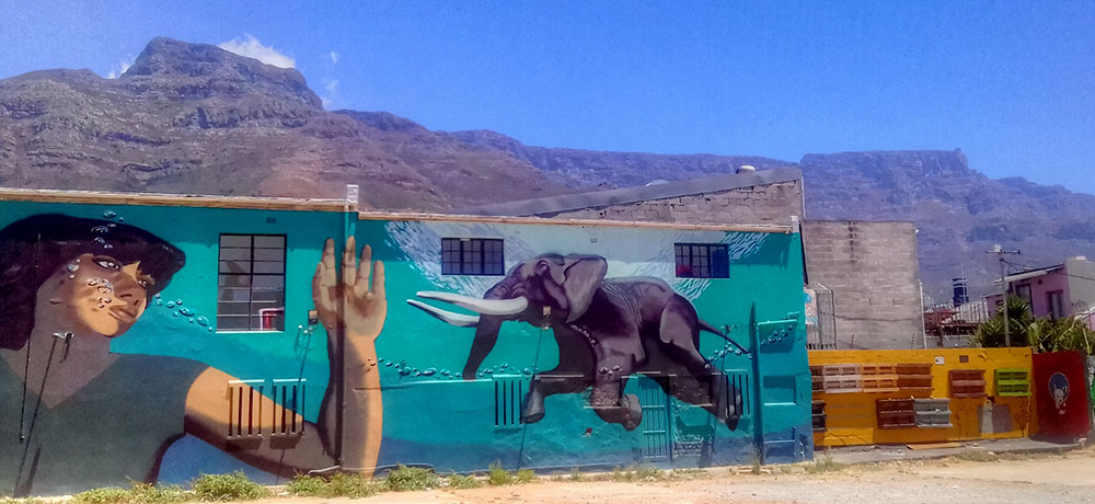 Amazing street art can be found throughout Woodstock in South Africa. Photo courtesy of yeowatzup.