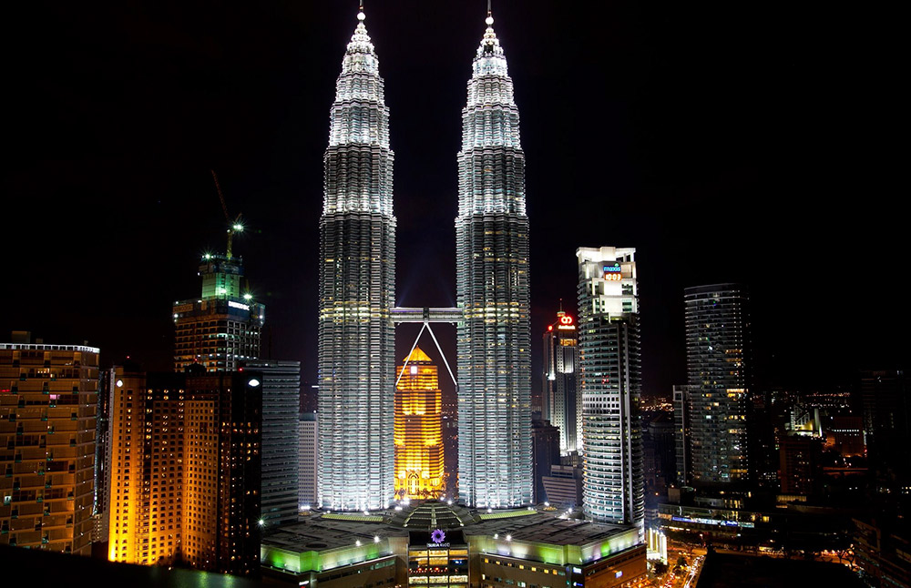 Evening – and dinner hour – take hold in Kuala Lumpur.