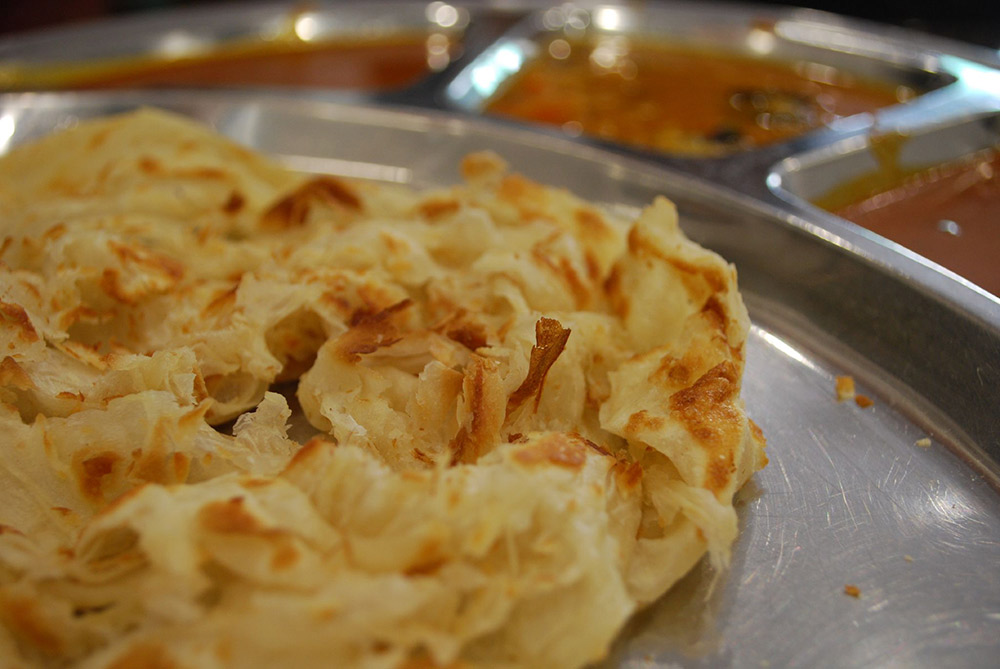 Try and watch the cook flipping the roti canai as its cooking for a real treat. Photo courtesy Alpha.