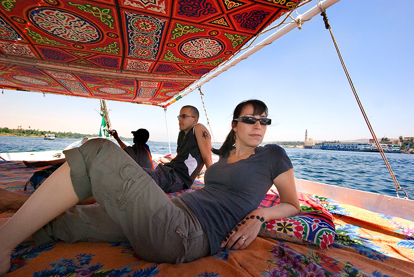 A felucca is an open-decked boat often covered in colourful cushions.