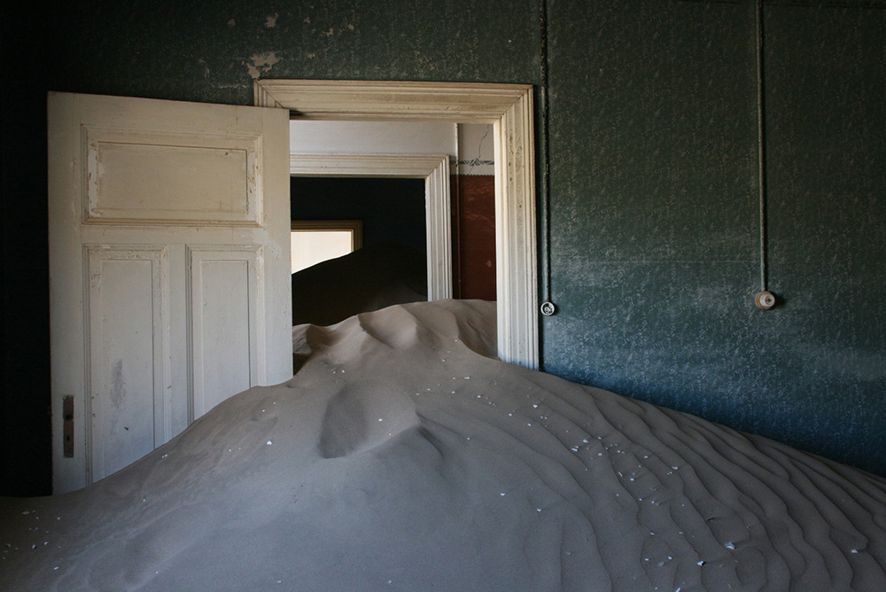 Kolmanskop's abandoned houses have filled with the sands of the Namib Desert. Photo courtesy of Michiel Van Bielen.