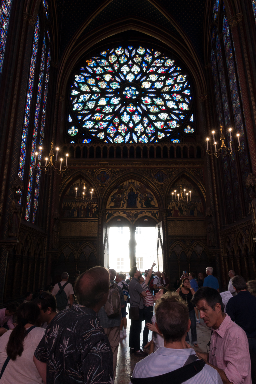 Include other elements in the frame to help show the size of the stained glass windows.