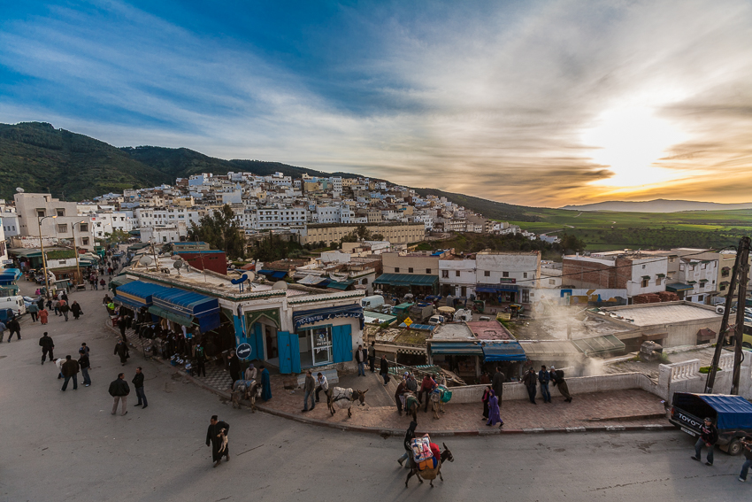 The sun has almost set as donkeys cart goods on the streets of Moulay Idriss Zerhoun.