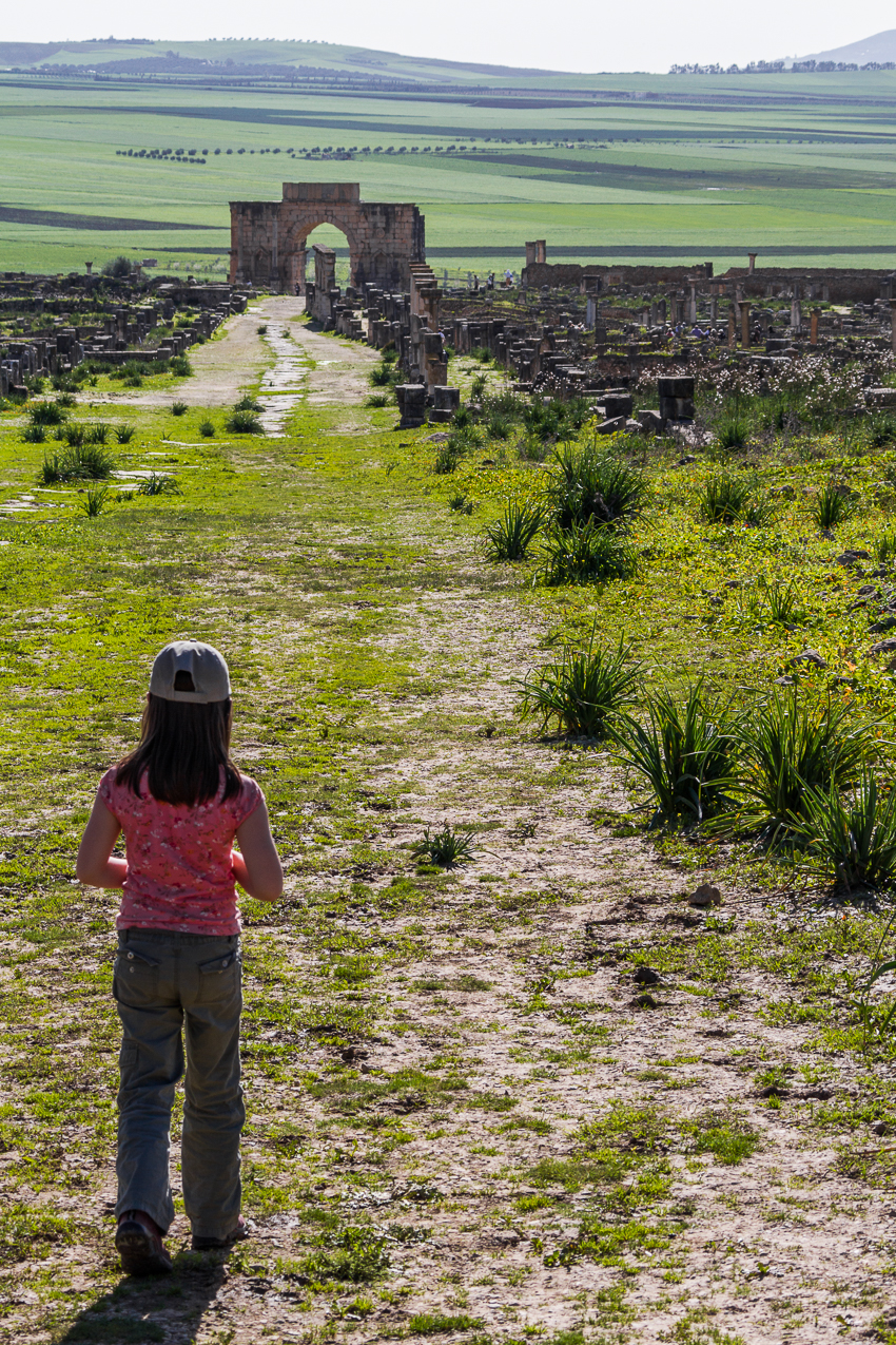 My daughter taking in the view along the Decumanus Maximus toward the Arch of Caracalla. This was the main road into the city, once lined with shops on both sides.