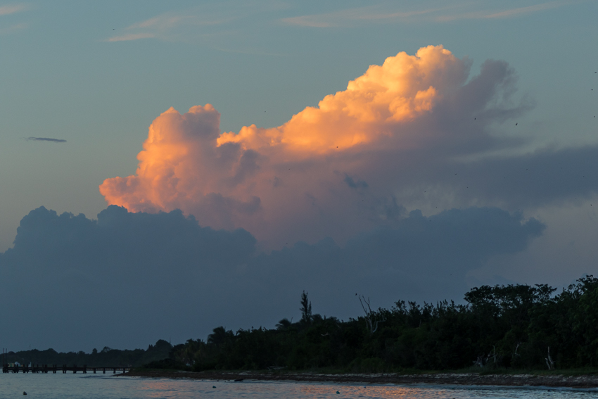 Thunderheads left behind from a passing hurricane glow in the upper atmosphere off the coast of Cozumel.