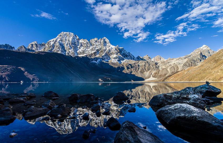 The Machermo range reflected in Dudh Pokhari, Nepal.