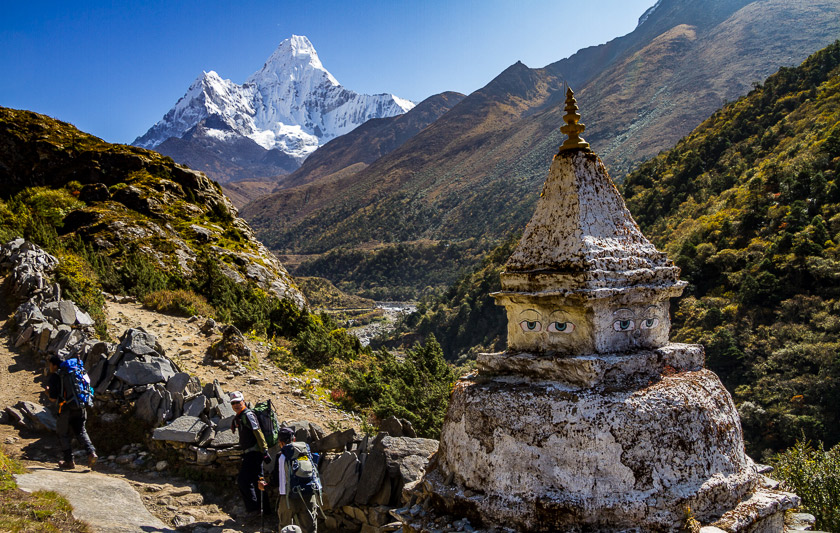 A stupa stands sentinel in front of Ama Dablam's towering peaks.