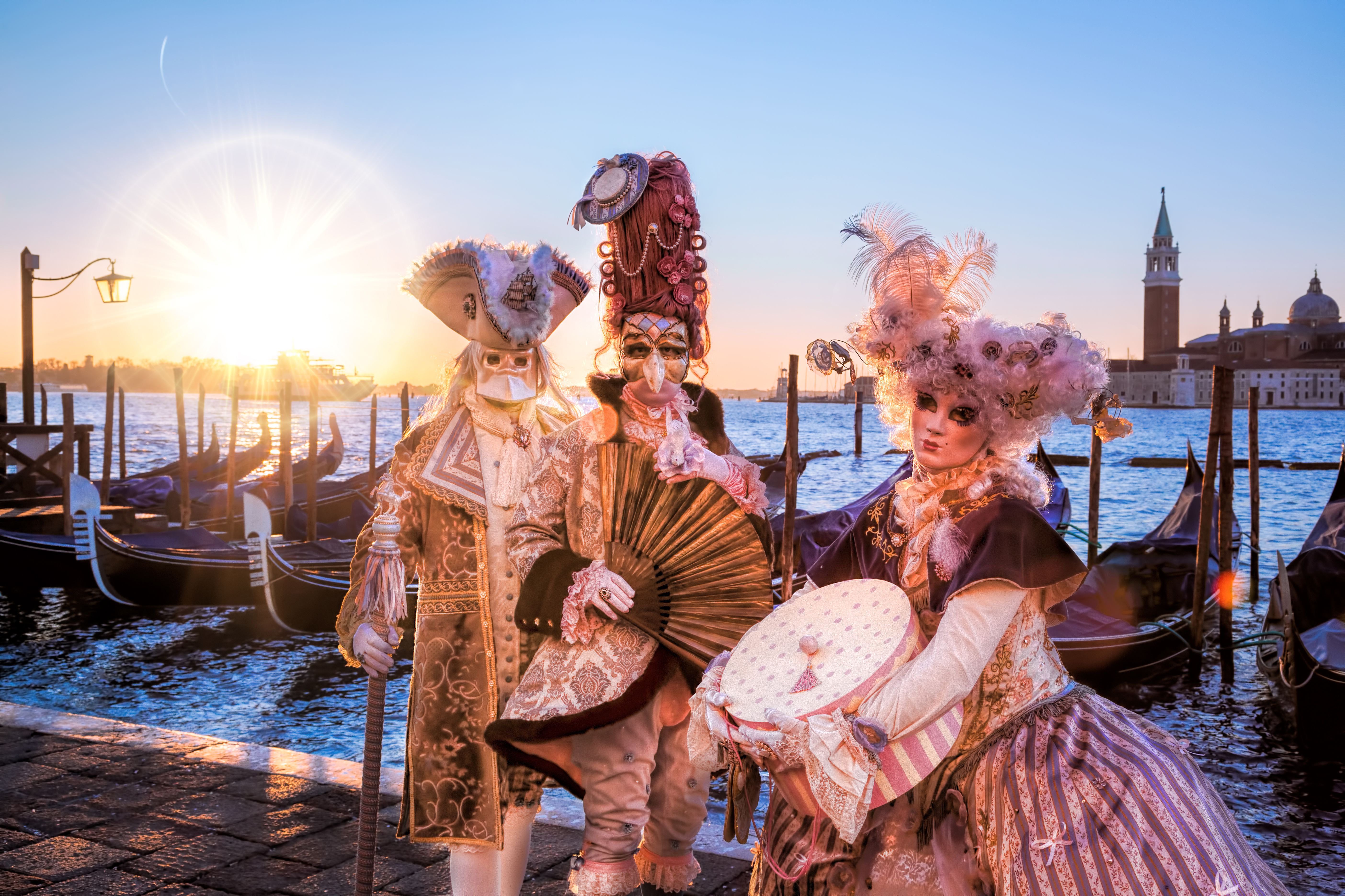 Masked revellers at Venice Carnival.