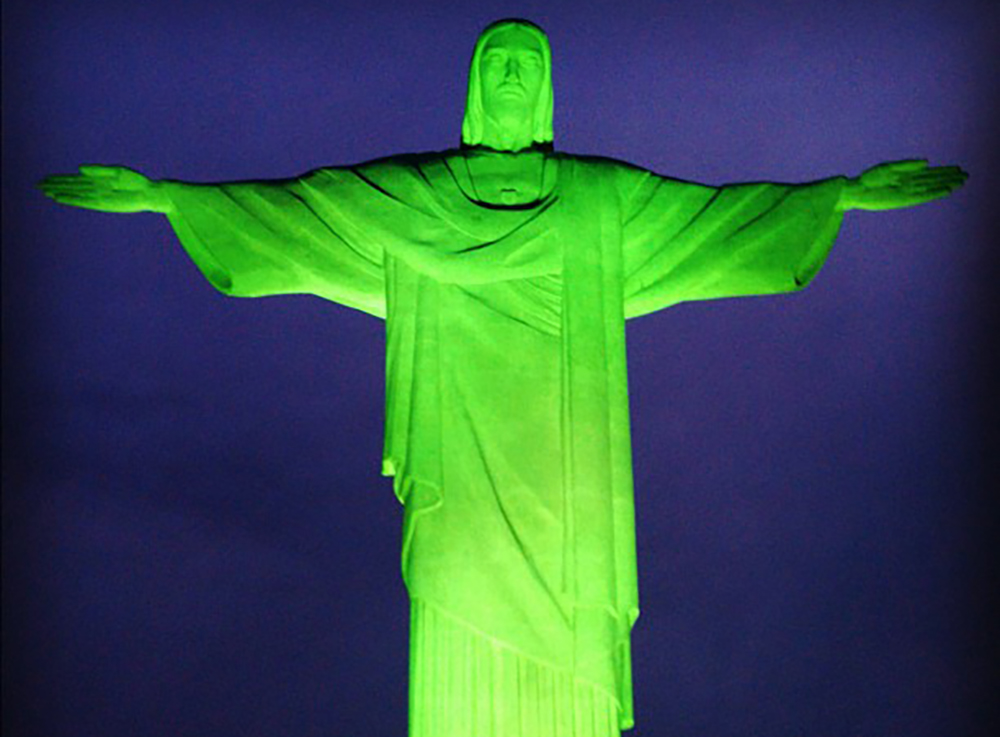 Rio's famous Christ the Redeemer statue, seen here lit green for the U.N. Summit in 2010, is also lit green on St. Patrick's Day. Photo courtesy of Art Jonak.