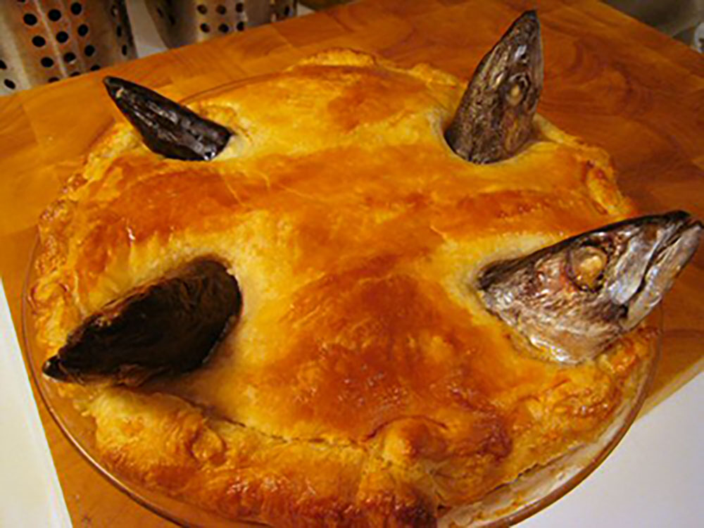 Stargazy pie is characterized by the sardine heads that poke through its top crust. Photo courtesy Krista.