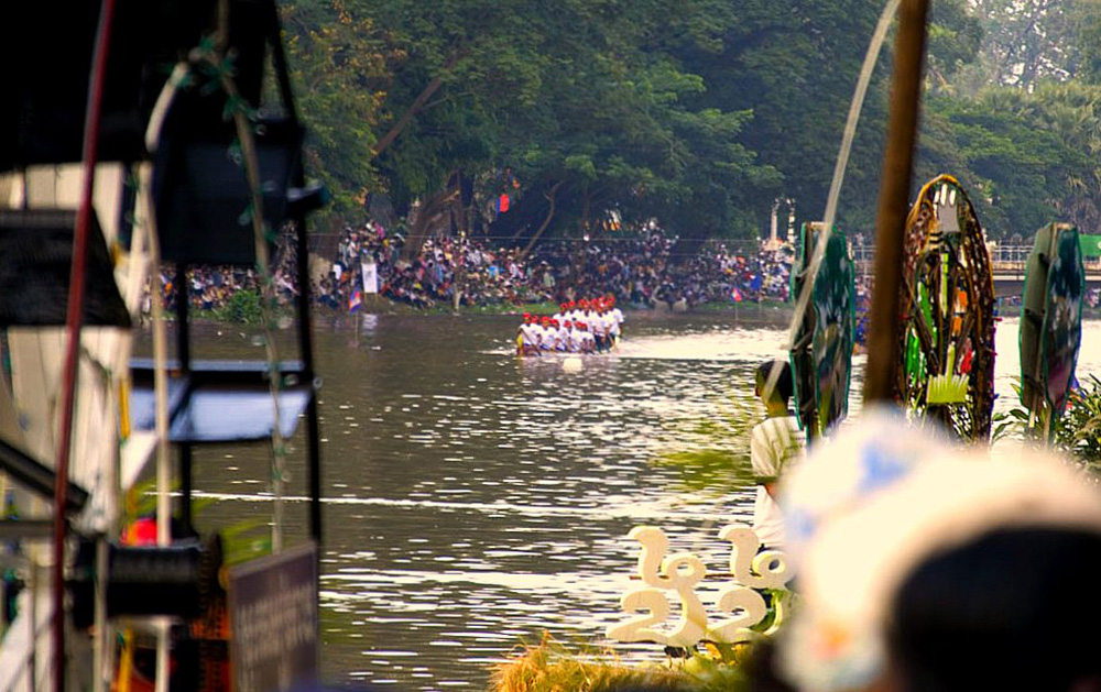 Boats racing during the Cambodian Water Festival. Photo courtesy of Jim Davidson.