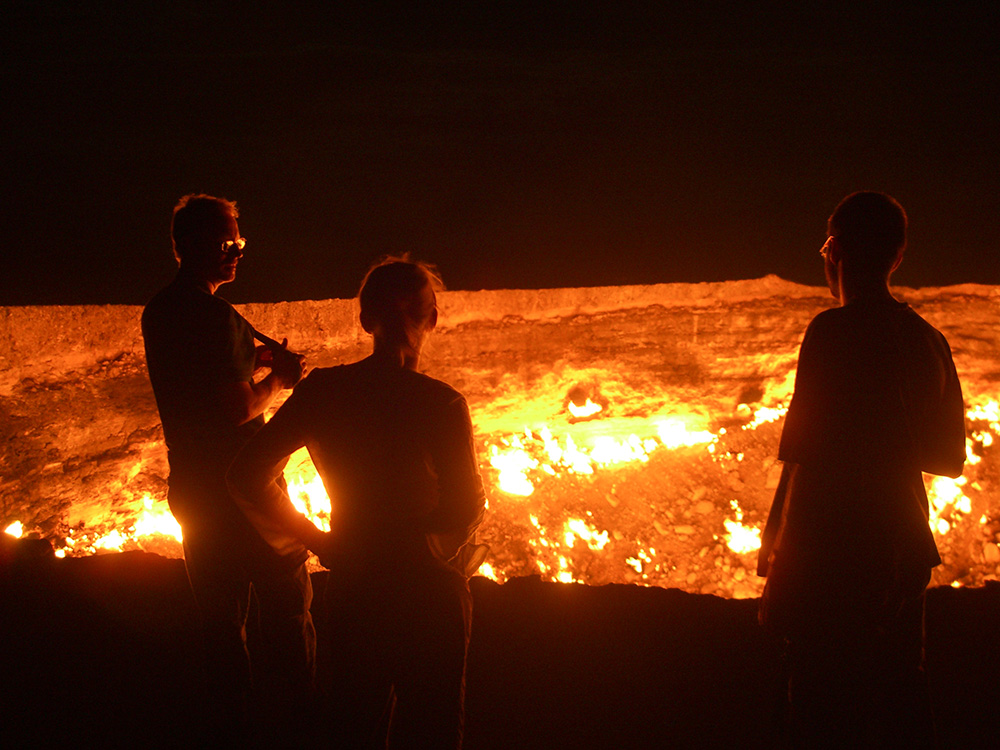 Feeling the heat from the never-ending flames of the Darvaza gas crater.