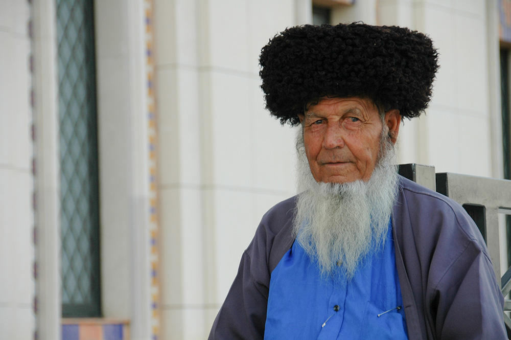 A Turkmen elder wears his telpek, a hat for all seasons.