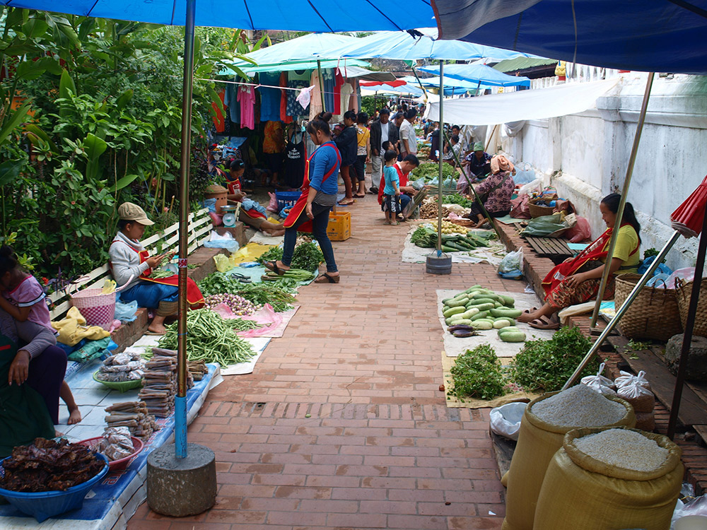 The food markets in Luang Prabang are bursting at the seams with fresh produce. Photo courtesy Iwan G.