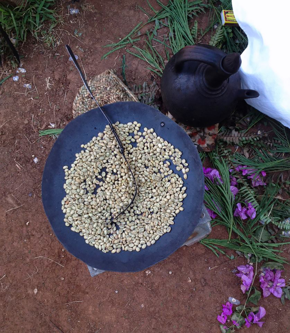 Green coffee beans being roasted in Ethiopia.